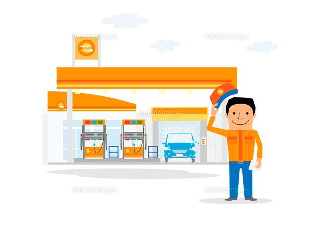 ガソリンスタンドと挨拶をするサービスマン
