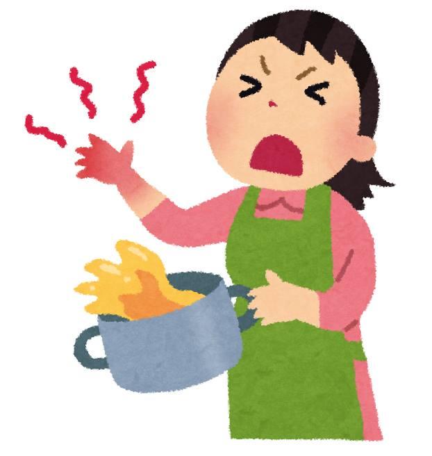 料理中に手をやけどする女性