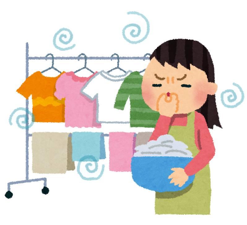 洗濯物と生乾き臭を気にする女性のイラスト